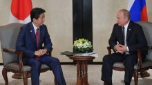 Japan's Abe says wants to discuss peace treaty with Putin today