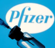 Chinese media criticise Pfizer COVID-19 vaccine, tout local shots
