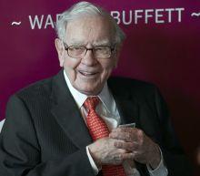 Buffett's firm sells off financials, halves Chevron stake