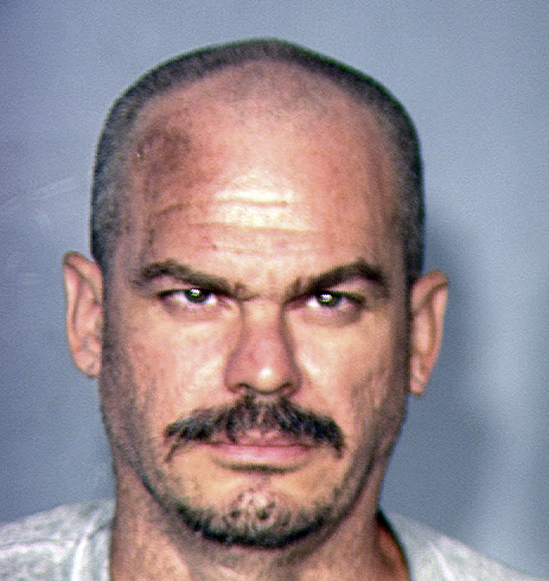 "This image provided by the Las Vegas Metropolitan Police Department shows David Allen Brutsche, 42, who was arrested on domestic terrorism charges in Las Vegas. A four-month undercover operation in Las Vegas led to the arrests of Brutsche and Devon Campbell Newman. The arrests stopped a plot to abduct, torture and kill police officers in an effort to bring attention the ""sovereign citizen"" movement, authorities said Thursday, Aug. 22, 2013. (AP Photo/Las Vegas Metropolitan Police Department)"