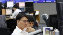 World shares mixed as China reports economic slowdown