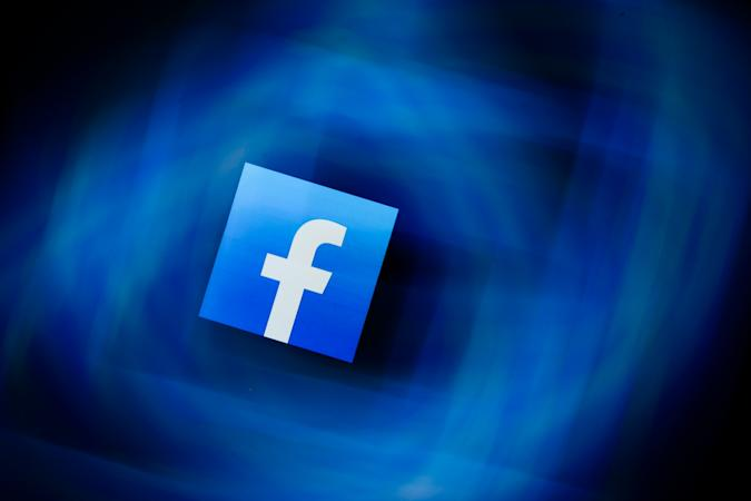 Facebook logo displayed on a phone screen is seen in this multiple exposure illustration photo taken in Krakow, Poland on January 16, 2020. (Photo by Jakub Porzycki/NurPhoto via Getty Images)