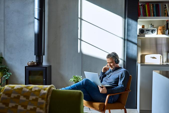 Man watching movie online with headphones, relaxation, leisure, enjoyment