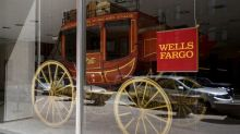 Wells Fargo's new chief pledges more cost cuts as profit slumps