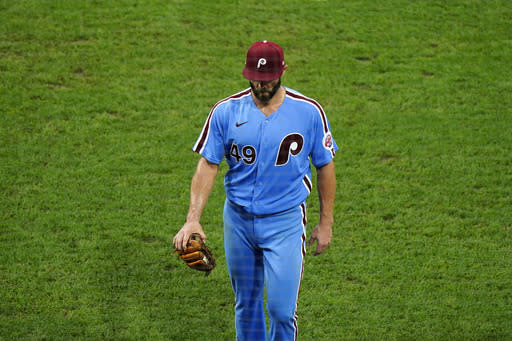 Philadelphia Phillies pitcher Jake Arrieta walks to the dugout after being pulled during the fifth inning of a baseball game against the Baltimore Orioles, Thursday, Aug. 13, 2020, in Philadelphia. (AP Photo/Matt Slocum)