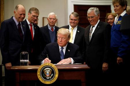 U.S. President Donald Trump participates in a signing ceremony for Space Policy Directive at the White House in Washington D.C., U.S. December 11, 2017. REUTERS/Carlos Barria