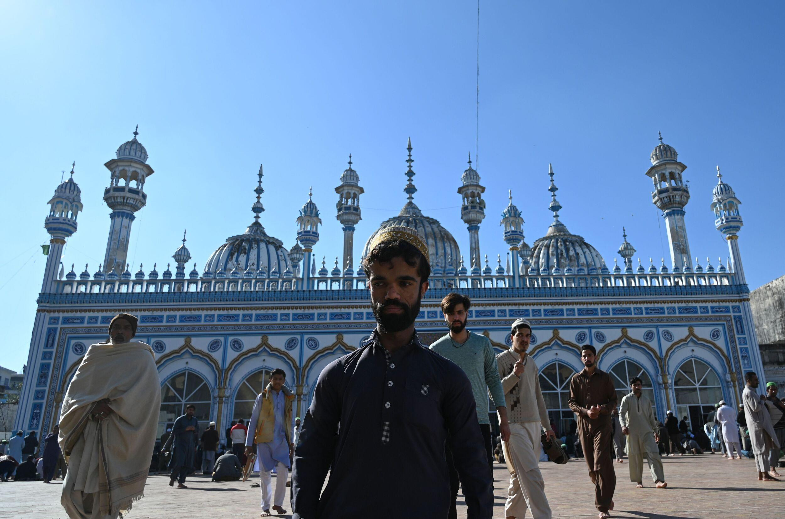 In this picture taken on February 22, 2019, Rozi Khan (C), a 25-year-old Pakistani waiter who resembles US actor Peter Dinklage, leaving a mosque after Friday prayers in Rawalpindi. - Rozi Khan had never heard of the Game of Thrones -- or its hugely popular character Tyrion Lannister -- until his striking resemblance to the dwarf anti-hero got heads turning at home. (Photo by AAMIR QURESHI / AFP) / To go with PAKISTAN-LIFESTYLE-TELEVISION-ENTERTAINMENT        (Photo credit should read AAMIR QURESHI/AFP/Getty Images)