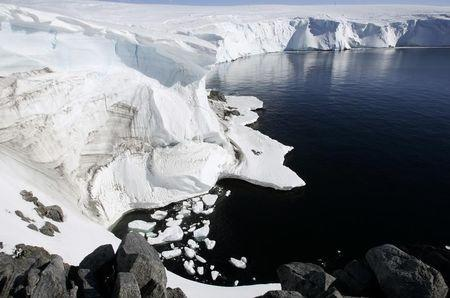 Melting ice shows through at a cliff face at Landsend, on the coast of Cape Denison in Antarctica
