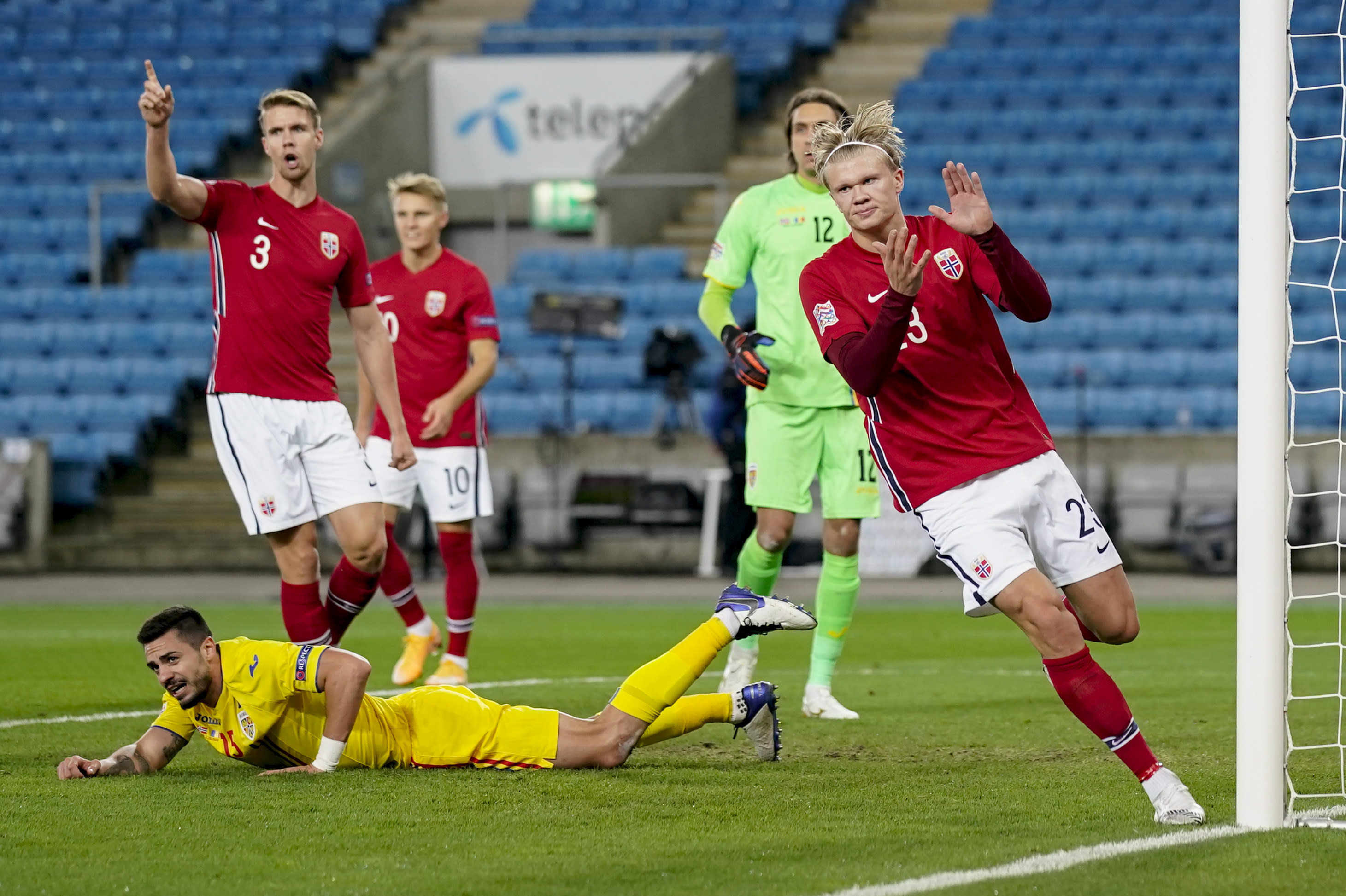 Norway's Erling Braut Haaland, right, celebrates after scoring, during the UEFA Nations League soccer match between Norway and Romania at Ullevaal Stadium, in Oslo, Sunday, Oct. 11, 2020, (Stian Lysberg Solum /NTB scanpix via AP)