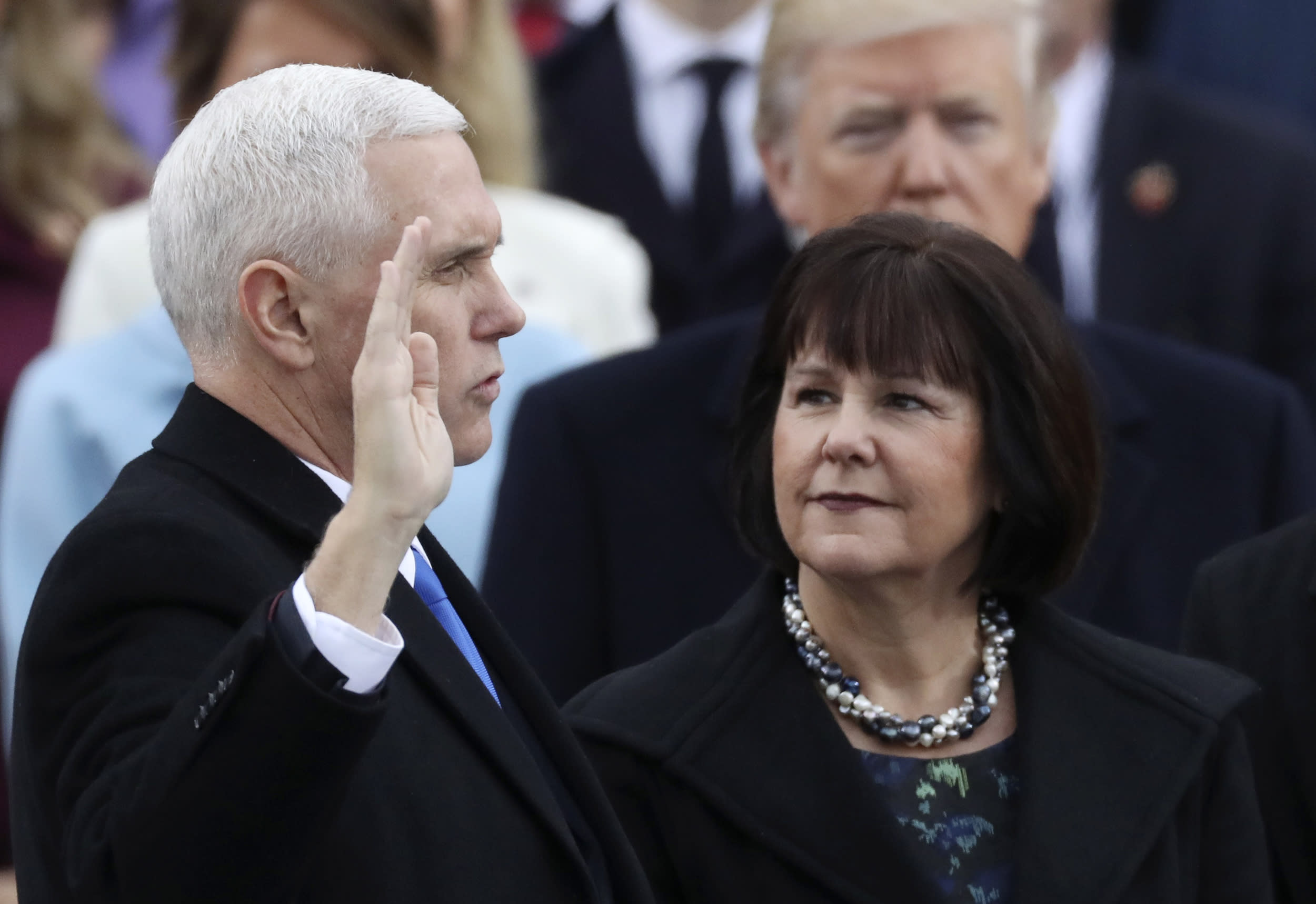 <p>Vice President Mike Pence is sworn in as his wife Karen Pence watches during inauguration ceremonies swearing in Donald Trump as the 45th president of the United States on the West front of the U.S. Capitol in Washington, U.S., January 20, 2017.</p>  <p>(REUTERS/Carlos Barria)</p>