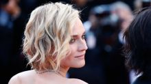 Diane Kruger looks like a modern-day Brigitte Bardot in this sophisticated black dress
