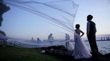 Coronavirus dampens celebrations in China's wedding gown city