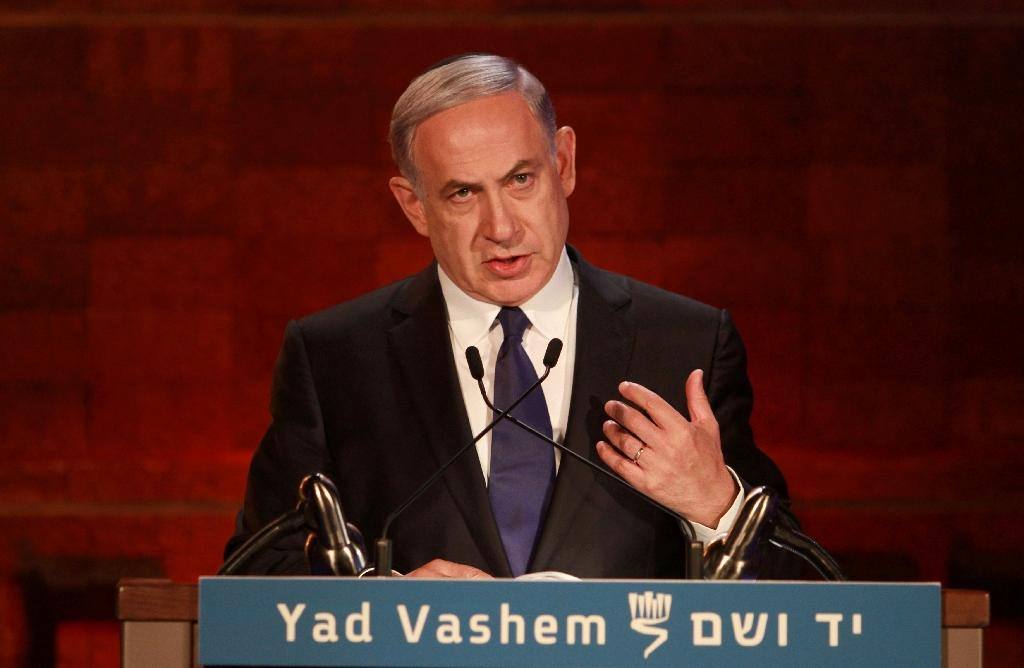 Israeli Prime Minister Benjamin Netanyahu delivers a speech during a ceremony marking the Holocaust Remembrance Day on April 15, 2015 at the Yad Vashem Holocaust memorial in Jerusalem