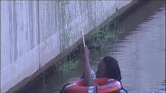Woman and dog rescued from canal near library