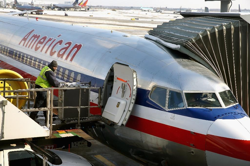 "American Airlines said a passenger's concern's over a fellow passenger's scribblings were ""not valid"""