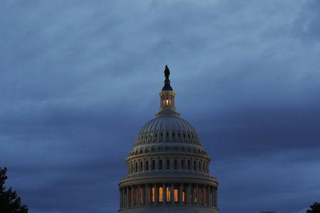 Storm clouds swirl over the U.S. Capitol building in Washington