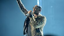 R. Kelly arrested, surrenders to Chicago police following sex abuse charges