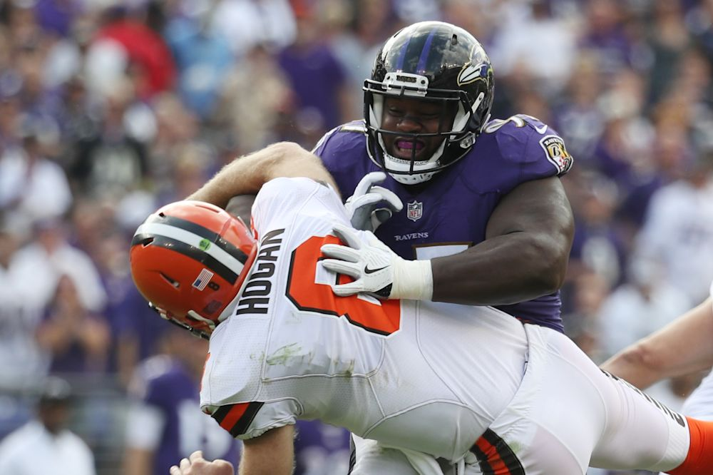 The Ravens' Michael Pierce hits Browns backup quarterback Kevin Hogan in the second quarter. (AP)
