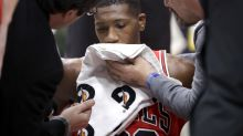 Kris Dunn hits floor face-first, busts teeth in scary post-dunk fall
