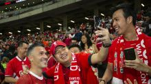 Die-hard supporters get their fanboy fix at Battle of the Reds