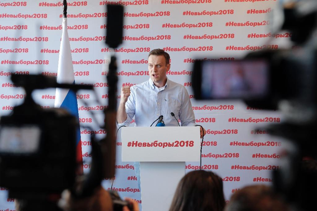 Putin's most vocal opponent Alexei Navalny was barred from running in the election (AFP Photo/Maxim ZMEYEV)