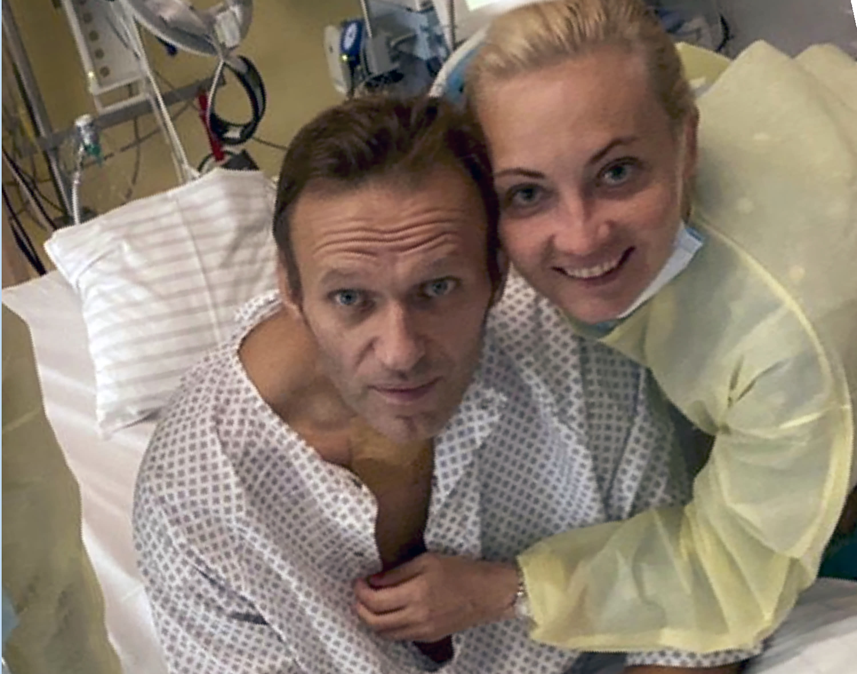 """This handout photo published by Russian opposition leader Alexei Navalny on his instagram account, shows himself and his wife Yulia, posing for a photo in a hospital in Berlin, Germany. Russian opposition leader Alexei Navalny has posted the picture Tuesday Sept. 15, 2020, with the caption """"Hi, this is Navalny. I have been missing you. I still can't do much, but yesterday I managed to breathe on my own for the entire day."""" (Navalny instagram via AP)"""