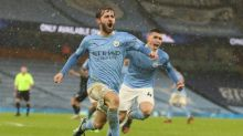 Man City move into first place after late show sinks Villa