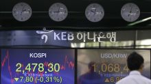 Asian shares fall back on trade worries, tech outlook