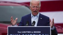 Biden slams Trump in Michigan on virus, offshoring