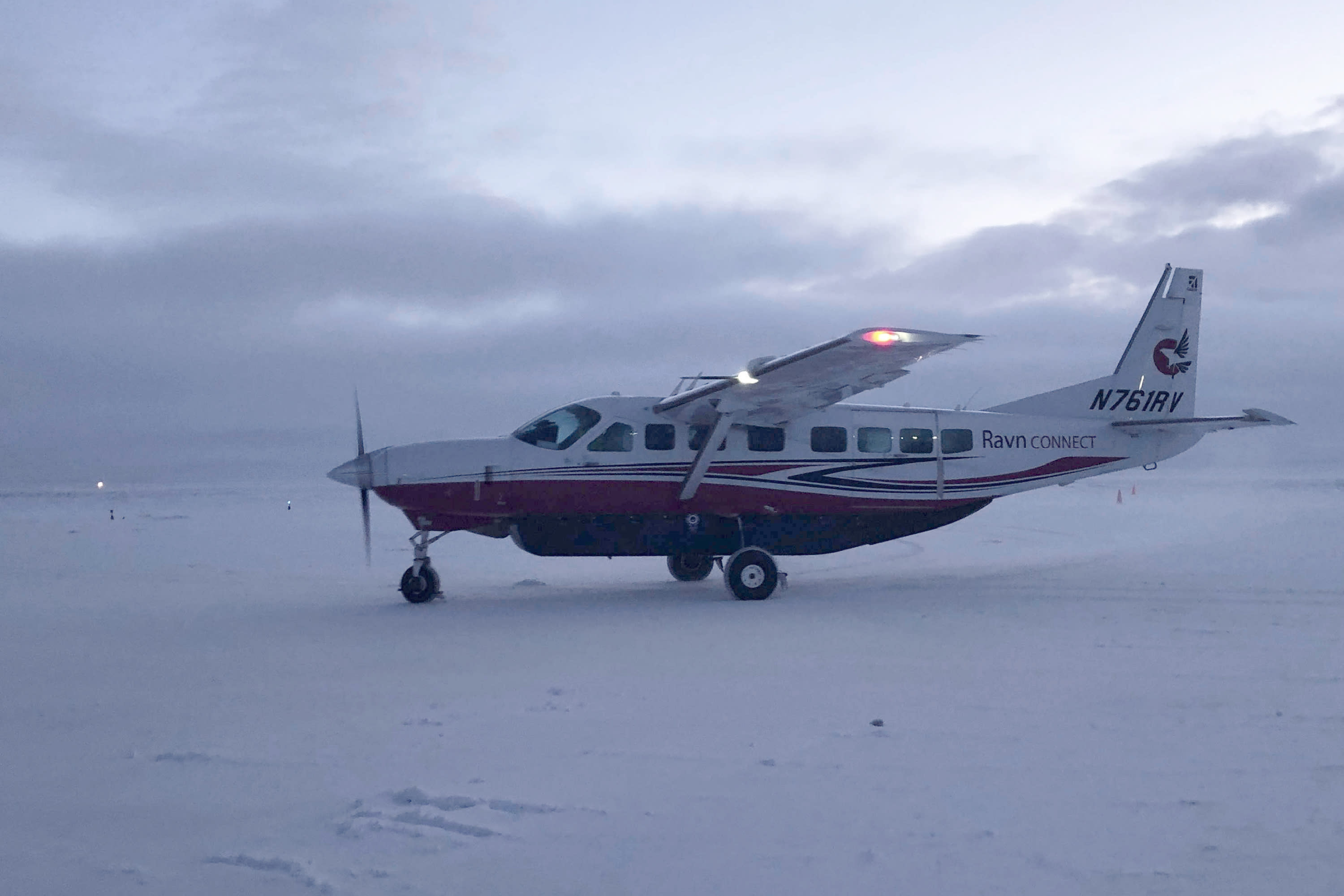 FILE - This Jan 22, 2020, file photo shows a Ravn Connect airplane landing at the airstrip in Toksook Bay, Alaska. The largest rural airline in Alaska has declared bankruptcy and laid off more than a thousand workers but wants $250,000 in bonuses to be awarded to its chief executive and other employees. Alaska Public Radio reported that RavnAir Group filed the request Tuesday, Aug. 11, 2020 in Delaware bankruptcy court. (AP Photo/Mark Thiessen, File)