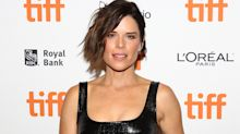 Neve Campbell stuns on TIFF red carpet in edgy black dress with thigh high slit:  Shop the look for less