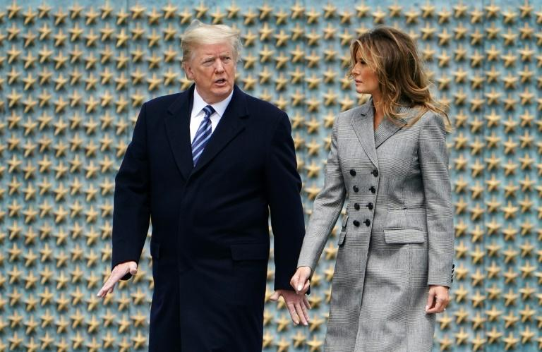 US President Donald Trump and his wife Melania at a small ceremony at Washington's WWII memorial