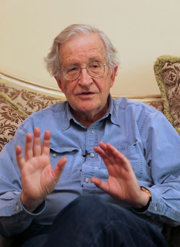 Noam Chomsky, a leading American intellectual highly critical of Israel's policies toward the Palestinians, gestures in Amman