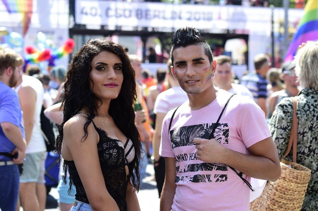 Syrian refugees, transgender Katia al-Shehaby and her twin brother Nour at the Christopher Street Day parade in Berlin (AFP Photo/Tobias SCHWARZ)