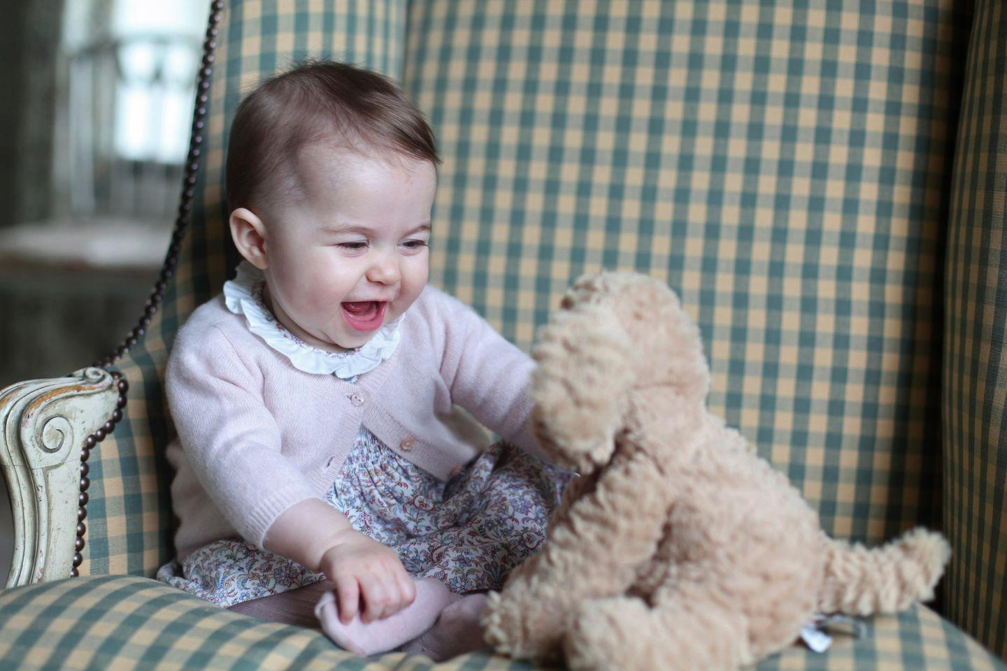 """<p>In addition to her royal duties, Duchess Kate is also a skilled photographer. Case in point, <span class=""""redactor-unlink"""">this candid portrait</span> of Charlotte with her favorite stuffed puppy. </p><p>Something of an early Christmas gift, the palace <a href=""""https://www.townandcountrymag.com/society/tradition/a4447/new-photos-princess-charlotte/"""" target=""""_blank"""">released a series of photos</a> in November 2015 along with the statement: """"The Duke and Duchess continue to receive warm messages about Princess Charlotte from all around the world and they hope that everyone enjoys these lovely photos as much as they do.""""</p>"""