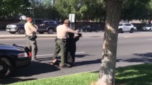 Mother shares video of armed police surrounding black son after they assumed he was attacker when teen called 911