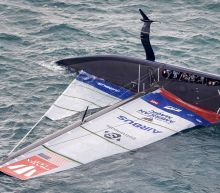 U.S. team sure of continuing in America's Cup after capsize
