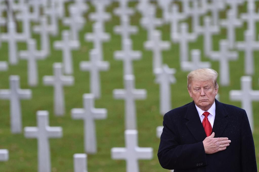 US President Donald Trump takes part in a ceremony at the American Cemetery of Suresnes, outside Paris, on November 11, 2018 as part of Veterans Day and commemorations marking the 100th anniversary of the 1918 armistice ending World War I