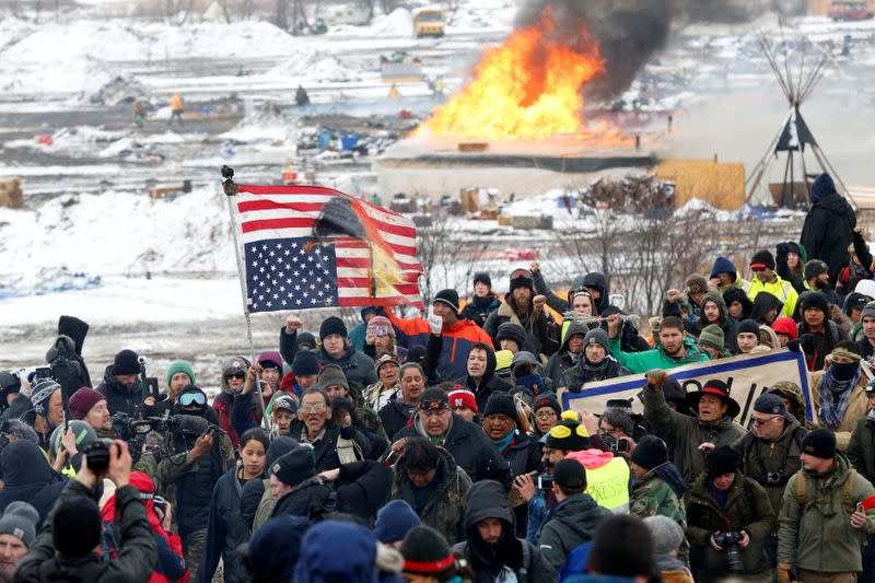 FILE PHOTO: Opponents of the Dakota Access oil pipeline march out of their main camp near Cannon Ball