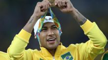 Neymar hands in the armband after captaining Brazil to Olympic gold