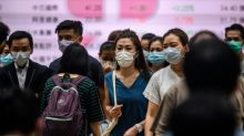 Success story Hong Kong reimposes tough new virus restrictions