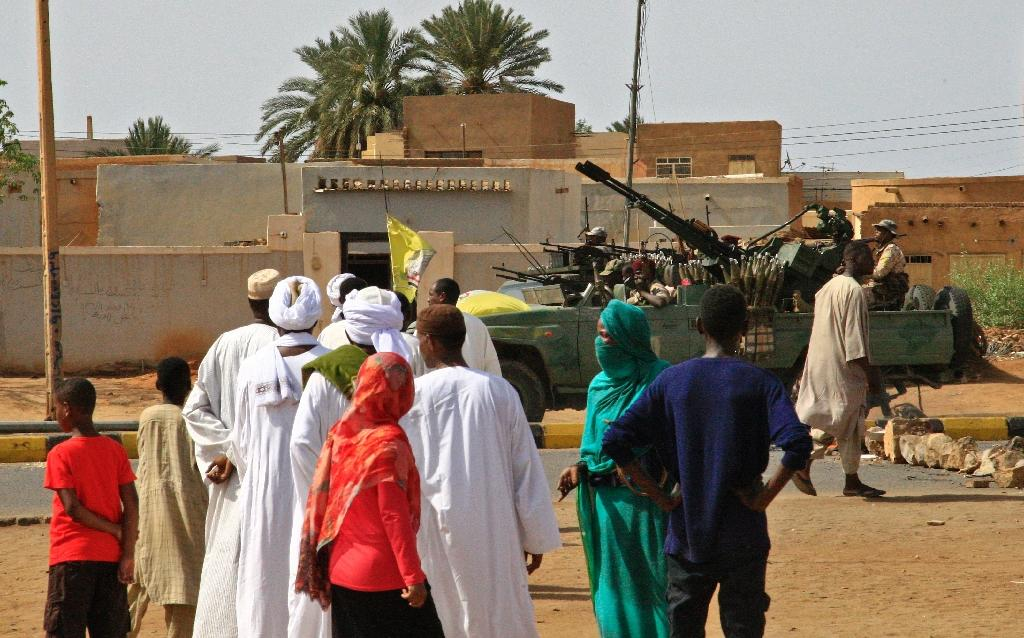 Heavily armed Sudanese security forces were out on patrol as Muslim worshippers attended Eid al-Fitr prayers (AFP Photo/-)
