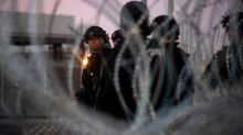 U.S. briefly shutters border crossing to brace for migrants