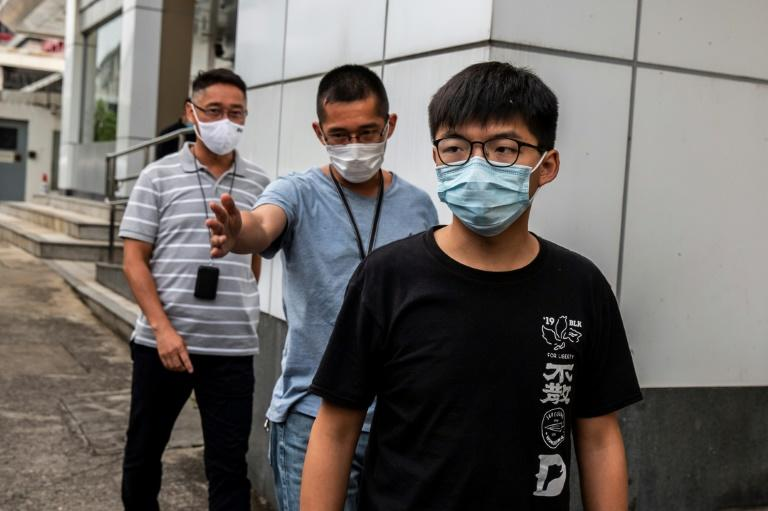 Pro-democracy activist Joshua Wong leaves Central police station in Hong Kong