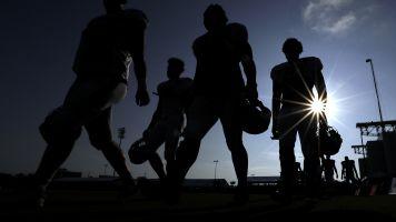 Surge reminds NFL who'll make call on season