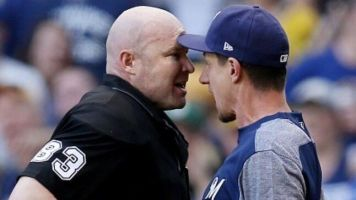 Brewers skipper goes at umpire after ejections