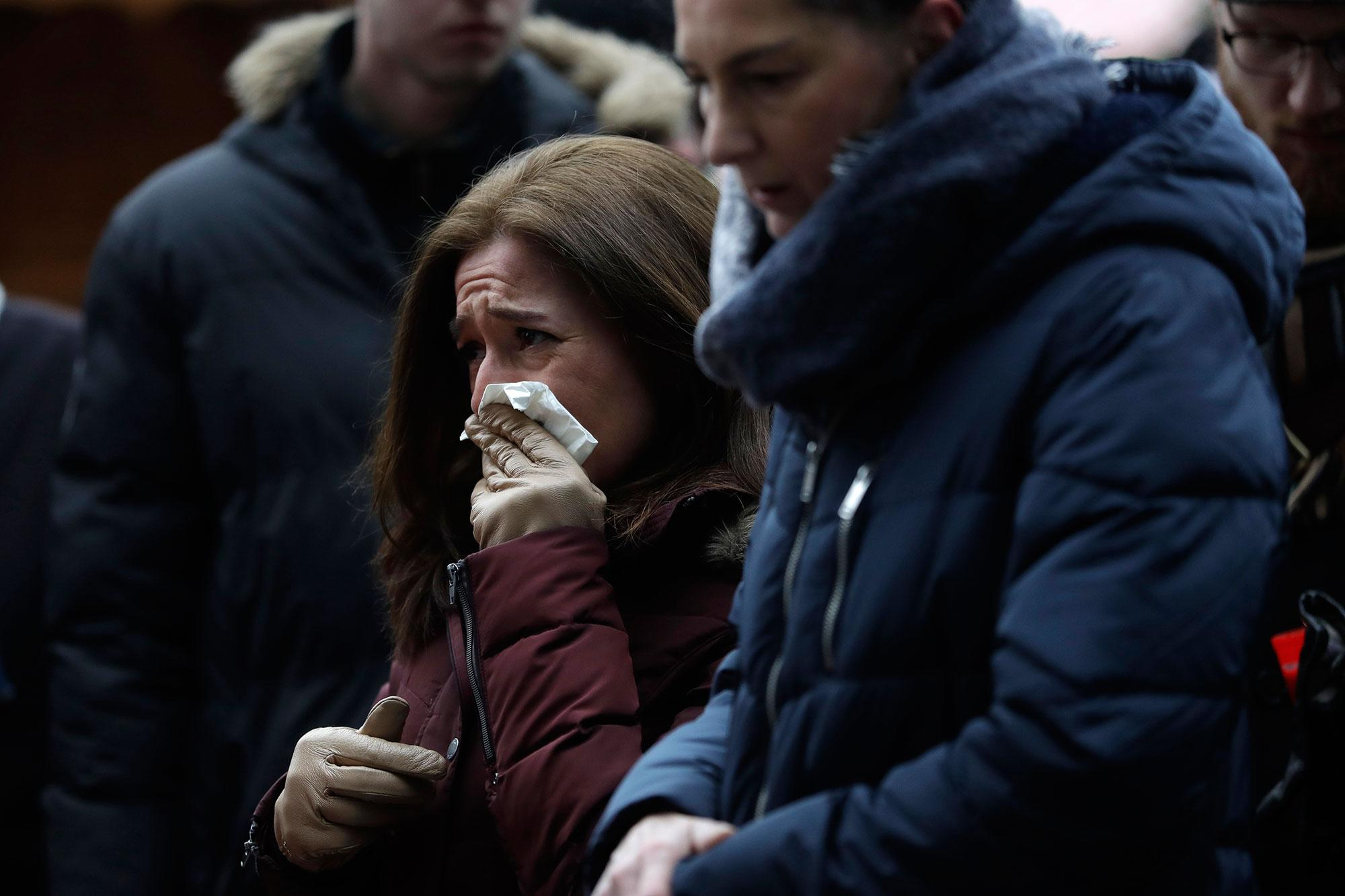 <p>People react near the crime scene in Berlin, Germany, Tuesday, Dec. 20, 2016, the day after a truck ran into a crowded Christmas market and killed several people. (AP Photo/Matthias Schrader) </p>