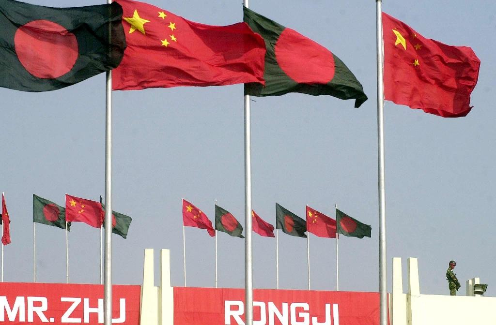 Bangladeshi and Chinese flags fly at Dhaka's Zia International Airport before then Chinese Premier Zhu Rongji's visit in 2002