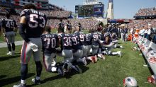 Photos: NFL players kneel during anthem as Trump fumes