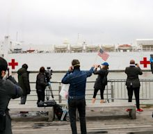 Photos show crowds of New Yorkers breaking social distancing rules and gawking at the USNS Comfort docked in Manhattan